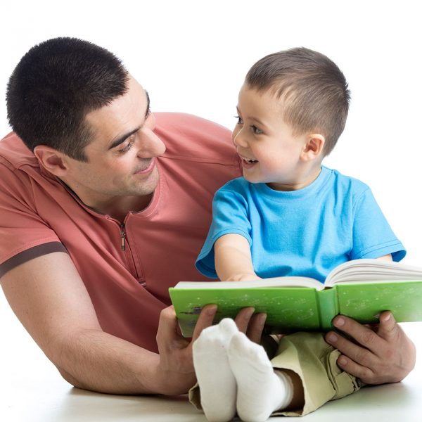 Dad and son reading book